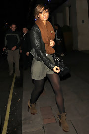 Frankie Sandford added kick to her stylish street wear with a pair of brown suede ankle boots with stacked heels.