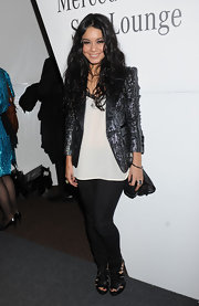 Vanessa Hudgens wore a shiny silver and purple sequined blazer during New York Fashion Week.