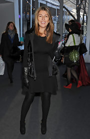 Nina Garcia was in the mood for black during Mercedes-Benz Fashion Week, wearing an LBD with a fur vest, gloves, tights, and ankle boots.