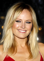 Malin Akerman paired her ravishing red gown with a smoldering brown shadow. She rimmed her lower lids for added drama.