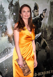 Diane Lane teamed her satin Escada dress with an earthy snakeskin clutch.