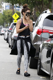 Vanessa kept her look simple and casual with a tied black tank.