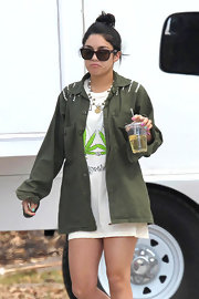 Vanessa Hudgens kept her on set style grungy in a studded olive jacket and a tunic length T-shirt.