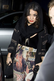Vanessa Hudgens was spotted in Soho with a black pashmina wrapped around her head.