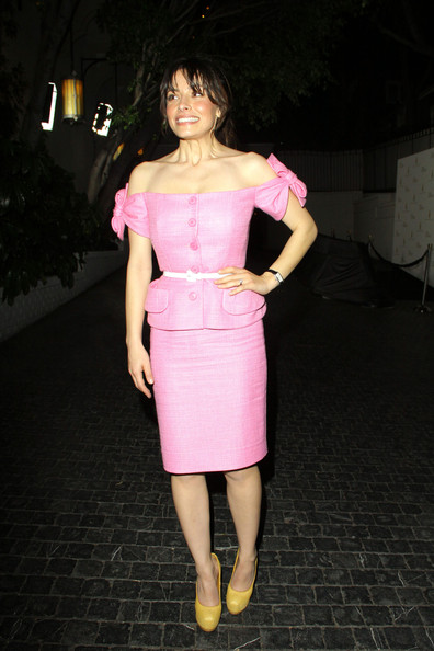 Vanessa got playful in a bubble gum pink woven skirt suit and yellow pumps for the Christian Dior pre-Oscar party.
