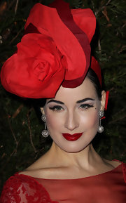 Dita Von Teese wore her signature shiny red lipstick at the 2012 Sidaction Gala Dinner.