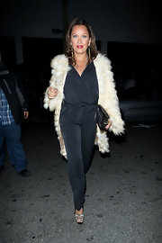 Vanessa channels the 70's in a black silk jumpsuit and fur coat while out in Hollywood.