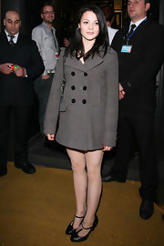 Kathryn covered up in a gray pea coat with fab black buttons.