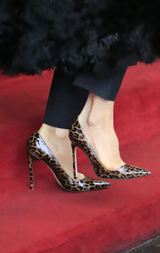 Victoria Beckham is known for her super posh, elegant style shown here with some leopard print pumps.