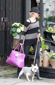 Although Sarah Harding's fuchsia patent tote was an adorable addition to her look, nothing was cuter than her sweet sweater-clad dog.