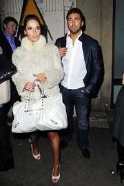 Katya carried a large white tote with stud embellishments. The purse matched her winter white fur jacket and pumps.