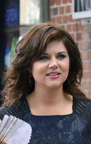 Tiffani Thiessen was hard at work on the set of 'White Collar' but still looked great with her feathery waves and side-swept bangs.