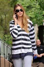 Whitney paired her striped hoodie with matching black and white-trimmed, round sunglasses.