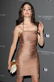 'Shameless' star Emmy Rossum rang in the new year carrying a Serra at Pera golden beige clutch.
