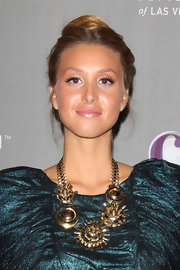 Whitney Port donned an 80s inspired teal frock to the opening of a Las Vegas nightclub. She finished off the look with bronzed skin and full lashes.