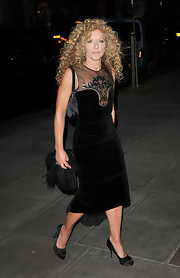 Kelly Hoppen topped off her black dress with satin platform pumps.