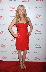 Rebecca Romijn added glamour to her sultry red mini with gold peep-toe sandals.