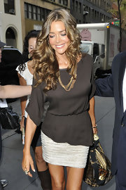 Denise Richards looked like a bronze goddess in New York City at 'The Today Show.' She wore a textured mini skirt paired with a brown blouse that she finished off with luxurious curls.