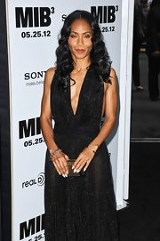 "Jada Pinkett Smith carried a black and gold ""seductress"" clutch with crystals to the premiere of 'Men in Black 3.'"