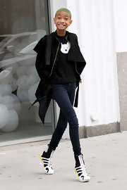 Willow Smith looked like she was strutting on stilts in skinny jeans and futuristic footwear.