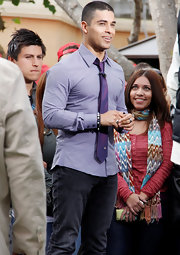 Wilmer Valderrama matched his shirt with a nice purple satin tie.
