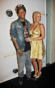 Wiz Khalifa stepped out with Amber Rose at the 'Laugh at My Pain' premiere in a pair of gray and black sneakers with hot pink accents.
