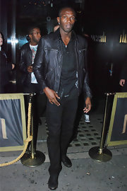 Usain steps out in a black leather jacket covered in Gucci Gs. Status check!