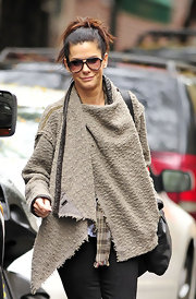 Sandra Bullock kept chic in NYC in aviator sunglasses.