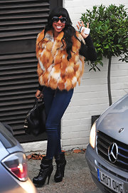 Kelly Rowland layered an over-the-top fur coat over her otherwise sleek ensemble.
