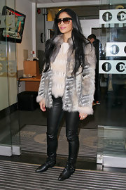 Tight leather pants and rocker-rough studded boots gave Nicole's chic look a tough moto-inspired vibe.