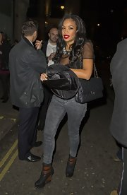 Rebecca Ferguson complemented her edgy outfit with an elegant quilted black bag by Chanel when she attended Rylan Clark's Halloween party.
