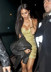 Nicole Scherzinger's geometric gold earrings matched her shimmering gold body-hugger well.