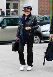 Yoko Ono looked every inch like someone who meant business with her leather briefcase in hand.
