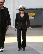 Yoko Ono showed off her prowess in power-dressing by donning a fitted suit and slacks as she took a walk along the East Village.