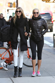 Yolanda Foster hit the streets sporting this casual and athletic puffa jacket.