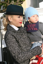 Gwen Stefani looked all too dapper in a wool trench coat and a dark green fedora hat.
