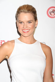 Alice Eve's pulled her hair back into a sleek and straight ponytail at the opening night of CinemaCon.