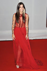 Christina made a sexy statement on The Brit Awards 2012 red carpet in this daring sheer gown.