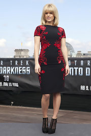 Alice Eve showed off her curves in this black and red floral-printed dress.