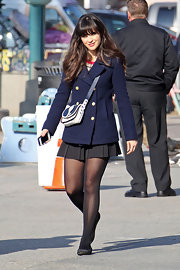 Zooey Deschanel looked darling as ever on the set of 'New Girl' in a pleated black skirt and a classic navy pea coat.