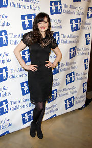 Zooey Deschanel paired her look with black pumps complete with bow detailing.