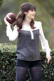 As always, Zooey looked adorable on the set of 'New Girl' throwing a football in this striped blousy top.