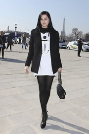 Leigh Lezark donned black leather ankle boots to the Jean-Charles de Castelbajac fashion show.
