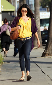Neve Campbell was a ray of sunshine in a ruffled canary yellow blouse.