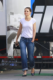 Katie wears a classic white tee with wide leg jeans.