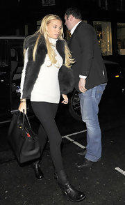 Petra Ecclestone balanced the volume of her fur vest with a pair of ultra-sleek black leggings.