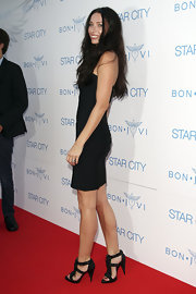 Erica Packet added a sultry edge to her black dress with black spike-embellished sandals.