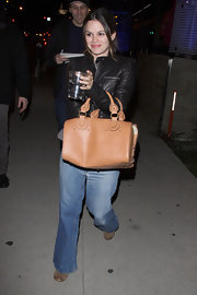 Rachel Bilson stays hydrated while carrying the practical and posh Aurore duffel bag.