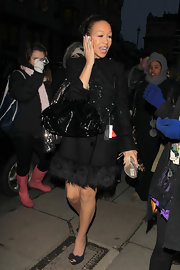 Rebecca Ferguson put her best foot forward in darling bow-adorned peep toe pumps. The black heels gave a girlie finish to her fur-trimmed coat.
