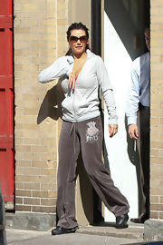 Jenni Farley kept things casual in a pair of taupe velour pants and a hoodie.